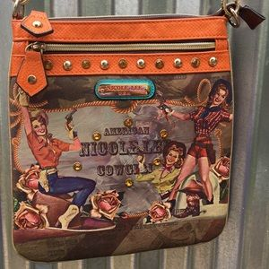 Nicole Lee crossbody purse.
